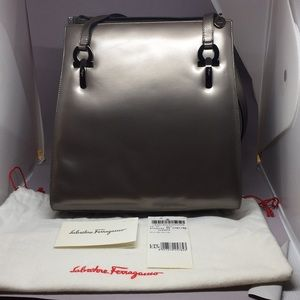 Like new  Ferragamo pearlized pewter leather bag